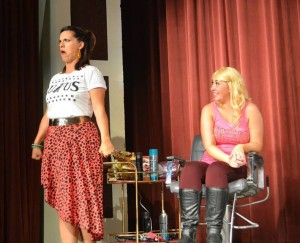 Amy Studabaker (left) is townie hairdresser Paulette and Peyton Cole is Harvard law student Elle Woods in the CrazyLake Acting Company production of