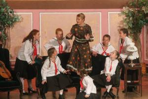 "Cast members of ""The Sound of Music,"" presented by Ricks-Weil Theatre Company in downtown Greenfield, engage in a singing lesson while testing the sturdiness of Austrian furniture. -- Photo provided"