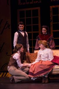 "Sisters Jo (Julia Bonnett, lower left) and Amy (Karen Woods Hurt) reconcile after the anger between them nearly led to tragedy, while friend Laurie (Ethan Litt) and sister Beth (Betsy Norton) look on in a scene from ""Little Women: The Broadway Musical"" at the Booth Tarkington Civic Theatre in downtown Carmel. -- Civic Theatre photo"