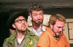 """Timon (Brian Hartz, center) is finally losing patience with the artist (Bradford Reilly, left) and poet (Taylor Cox) who had been so eager to take his money in Shakespeare's """"Timon of Athens,"""" presented by Casey Ross Productions at the 2015 Bard Fest in Carmel, Ind."""