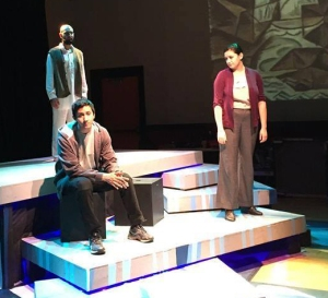 """Elloit (Mauricio Miranda, front, left) and his cousin Yazmin (Elysia Rohn, right) deal with the death of the woman who raised them, among other issues, while the ghost of an Iraqi Elliot killed (Sunny Arwal) haunts in the background in a scene from """"Water By The Spoonful,"""" presented by Wisdom Tooth Theatre Project at the IndyFringe Theatre in downtown Indianapolis. -- Wisdom Tooth photo"""